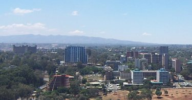 Community area of Nairobi with Ngong Hills in the background.