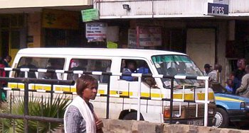 A matatu picking passengers on Tom Mboya street, Nairobi