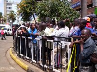 Crowds outside the burnt Nakumatt Downtown supermarket.