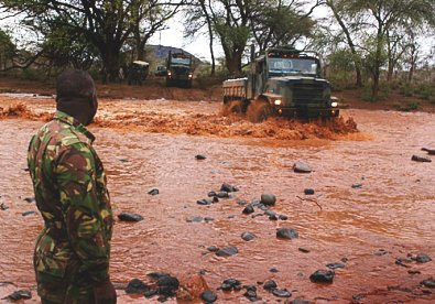 A Kenya Army column crossing a flooded river. Picture by the US Army.