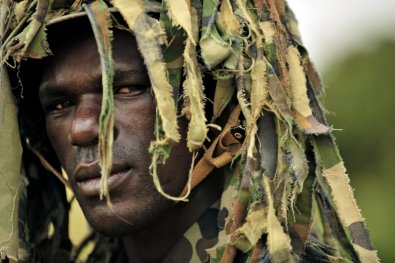 A Ugandan soldier in combat dress.