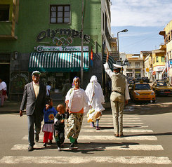 Eritrean family crossing a street in Asmara. This is perhaps the only country in Africa where people cross the streets at the right place!