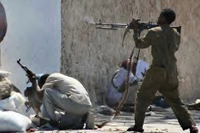 A Somali fighter firing a heavy machine gun in Mogadishu. Prolonged chaos has left Somalia flooded with weapons.