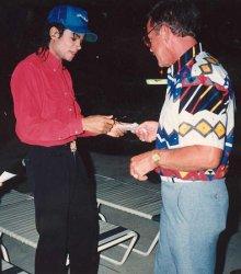 Michael Jackson signs an autograph for a fan.