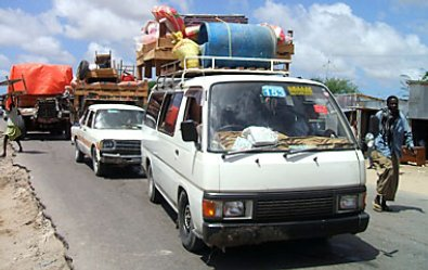 Somali citizens using public transport vehicles to flee from the escalation of fighting in the capital of Mogadishu.