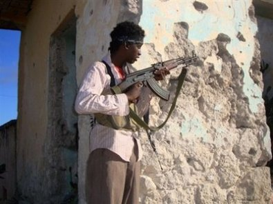 A Somali teenager taking position during heavy fighting between pro-government forces and Islamist militias. In Somalia, armed groups frequently shift their loyalties making it extremely complicated for foreigners to understand the situation.