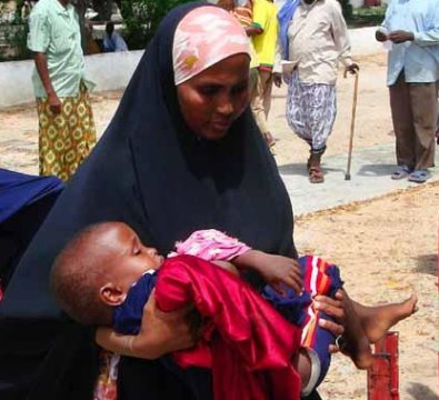 A woman carrying a wounded child to hospital. Civilians have suffered heavy casualties as combatants fire rockets and mortars indiscriminately. Iraq-style roadside bombings and suicide attacks have lately emerged in Somalia. Picture by the Kuwait Times.