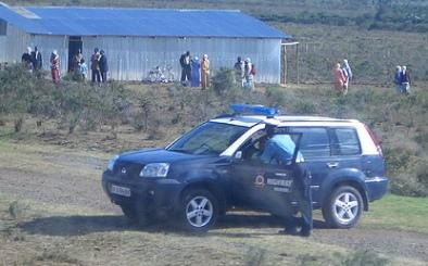 A police patrol car in the country side.